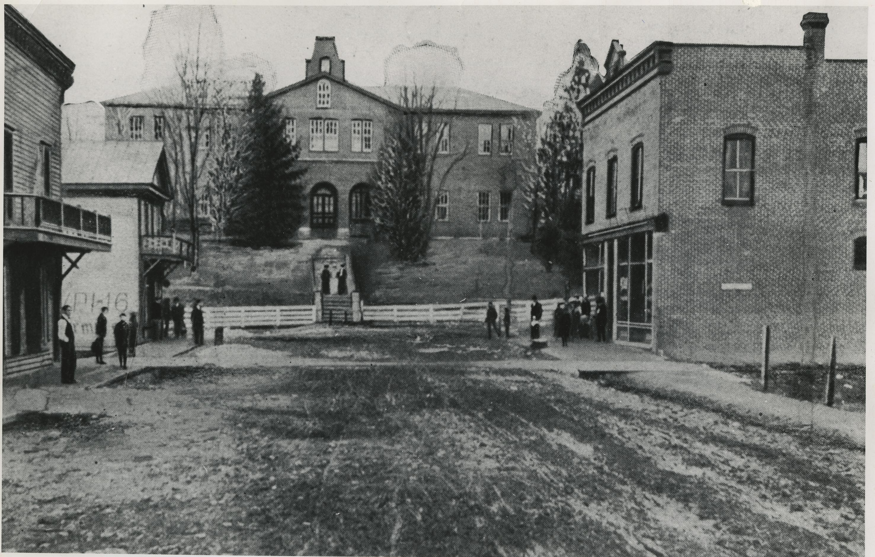 If you stood smack in the middle of Main St., right past the College Ave. intersection (think: right in front of Moe's--please don't try it!) and looked up hill, this is what you'd see in 1900. No Main St. or Alumni Mall entrance to campus. The building, which had been the original Preston and Olin Institute, was then being used as the machine shop.