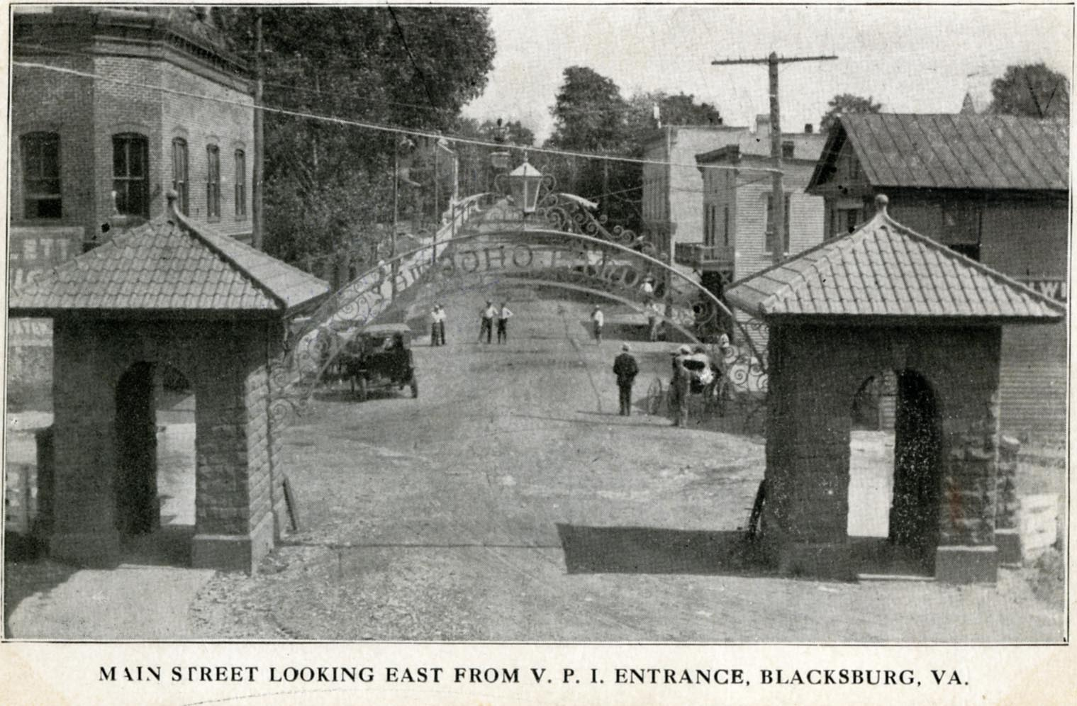 This image is actually the front of a postcard, sent in 1917. By then, the metal gates from the 1904 photograph were actually brick structures with a sign and Main St. was no longer a dead-end, but an entrance to campus!