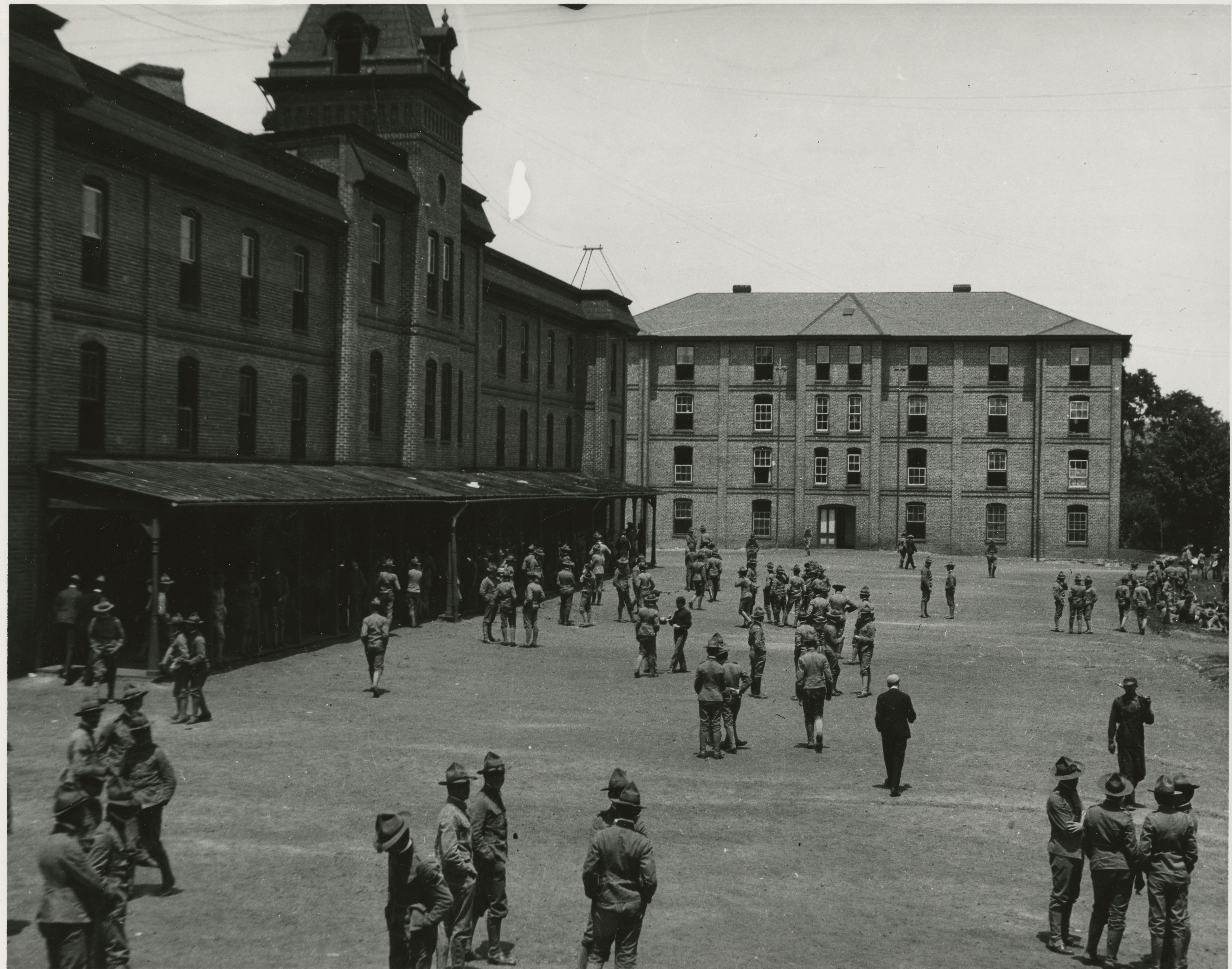 Upper Quad, before 1950. Barracks No. 1 (now Lane Hall) on the left. Rasche Hall (old Barracks No. 2 plus additions) at the center.