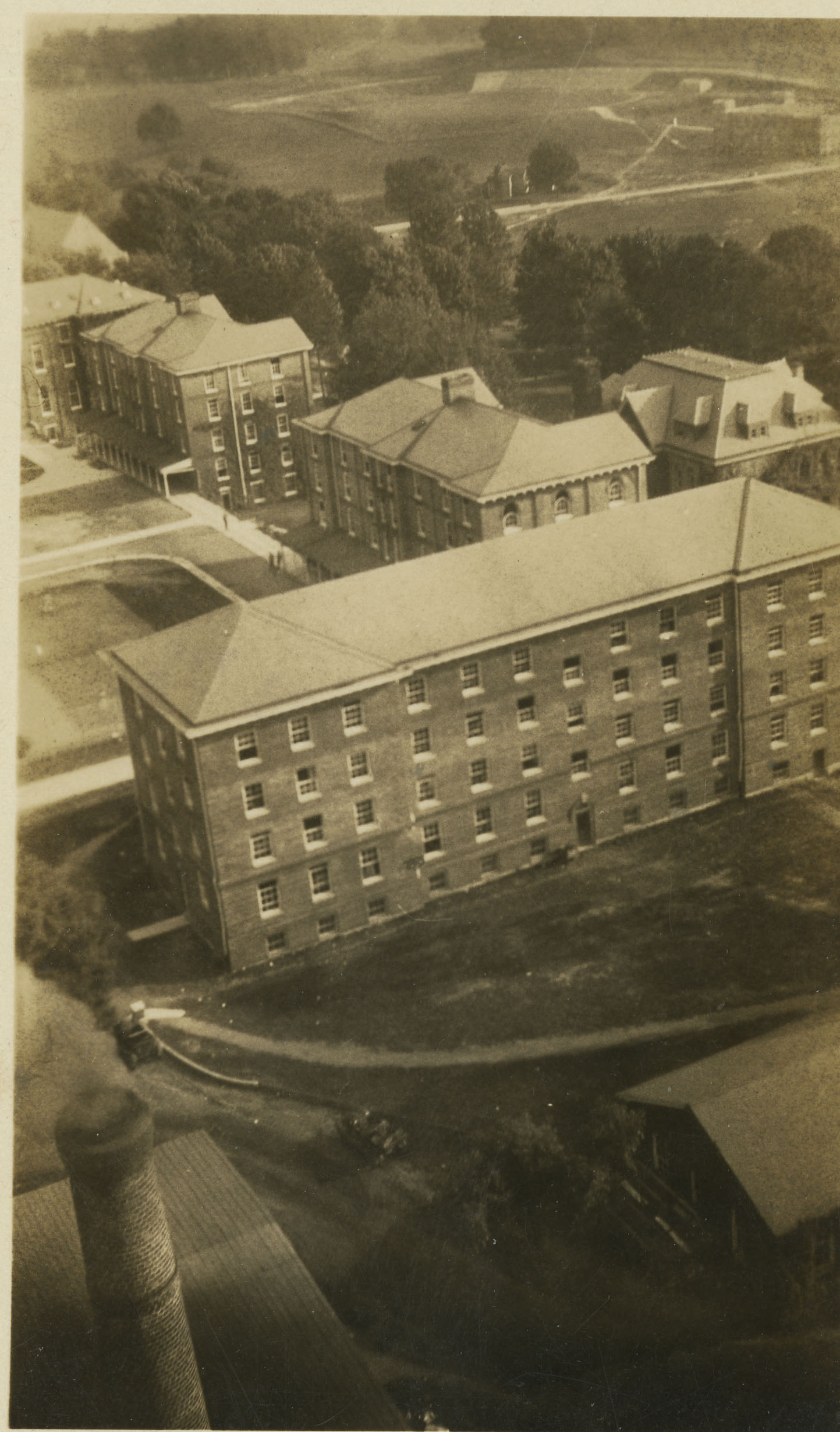 Undated, apparently taken from the smokestack. Barracks No. 6 is at the center, with No. 5 just behind it. To the right of the No. 5 is the old YMCA building.
