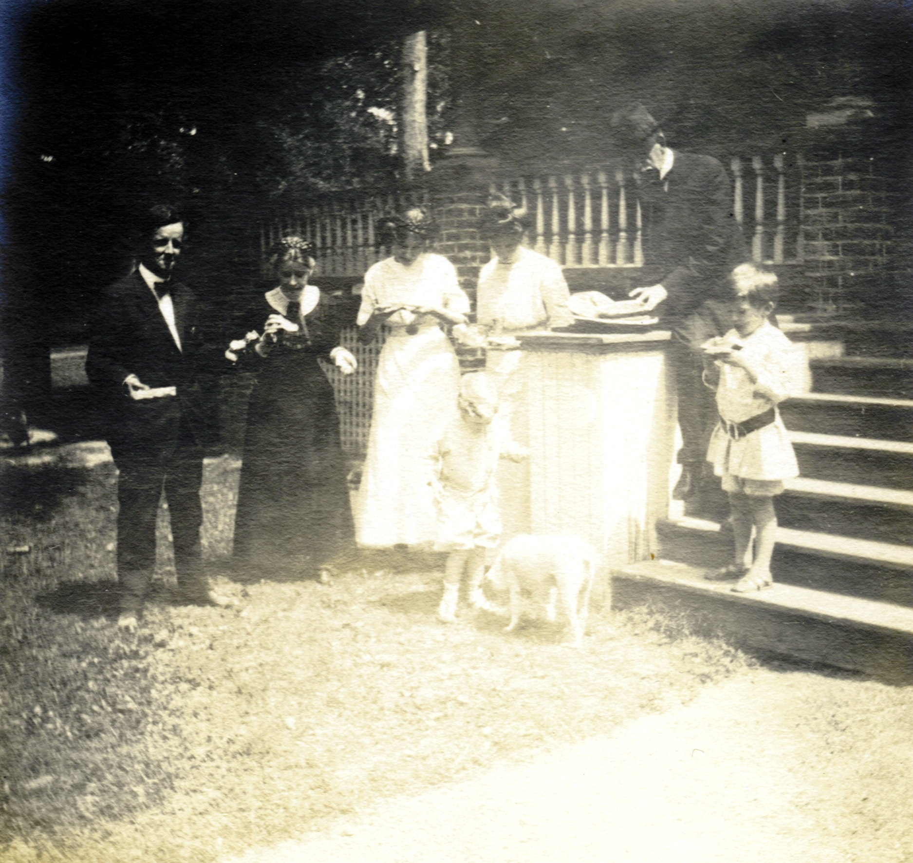 Cora Bolton McBryde (second from left), President McBryde (second from the right), and family enjoy a snack