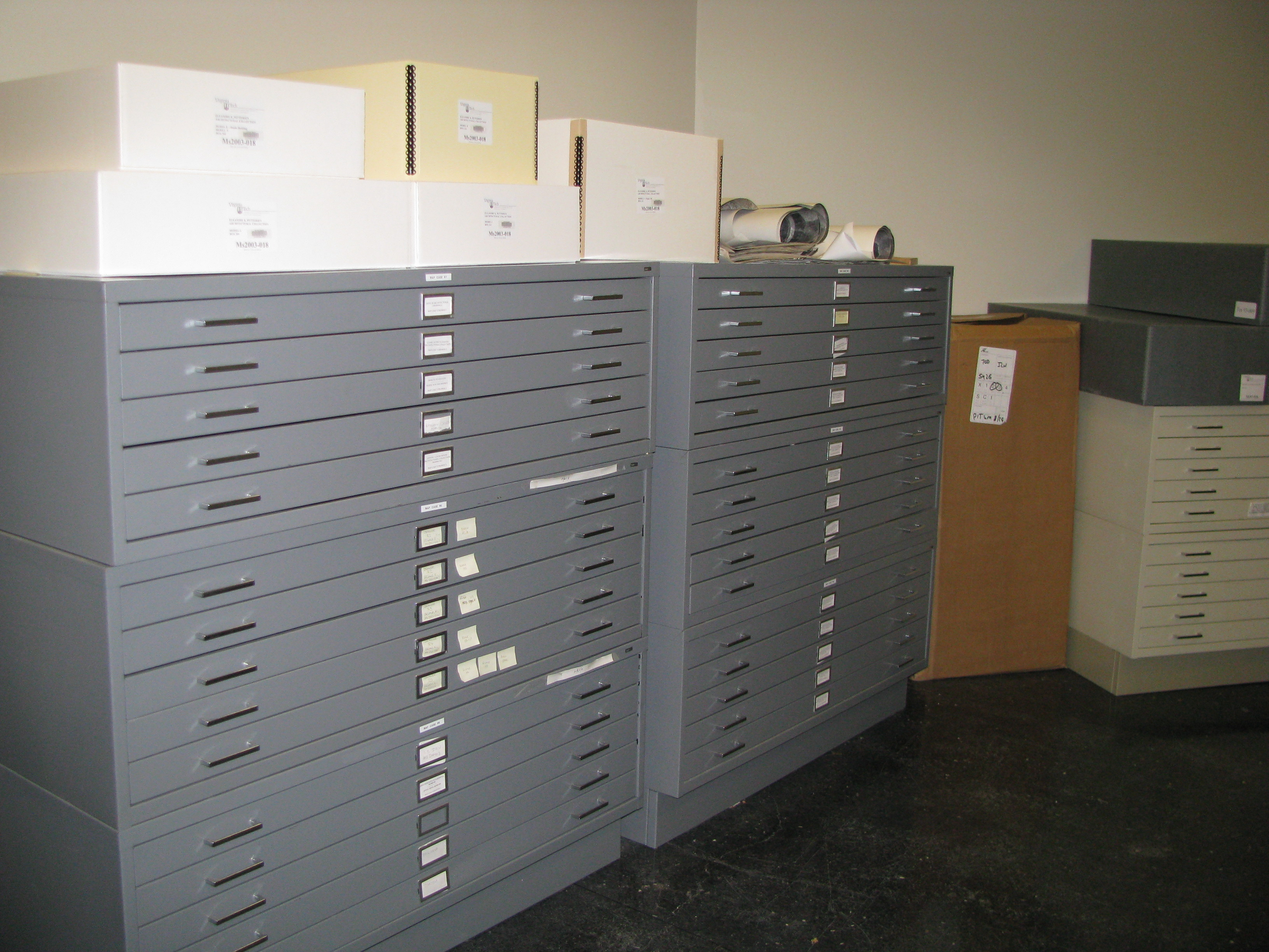 Boxes on top of these map cases contain textiles (while will be moved to new shelving soon) and architectural models.