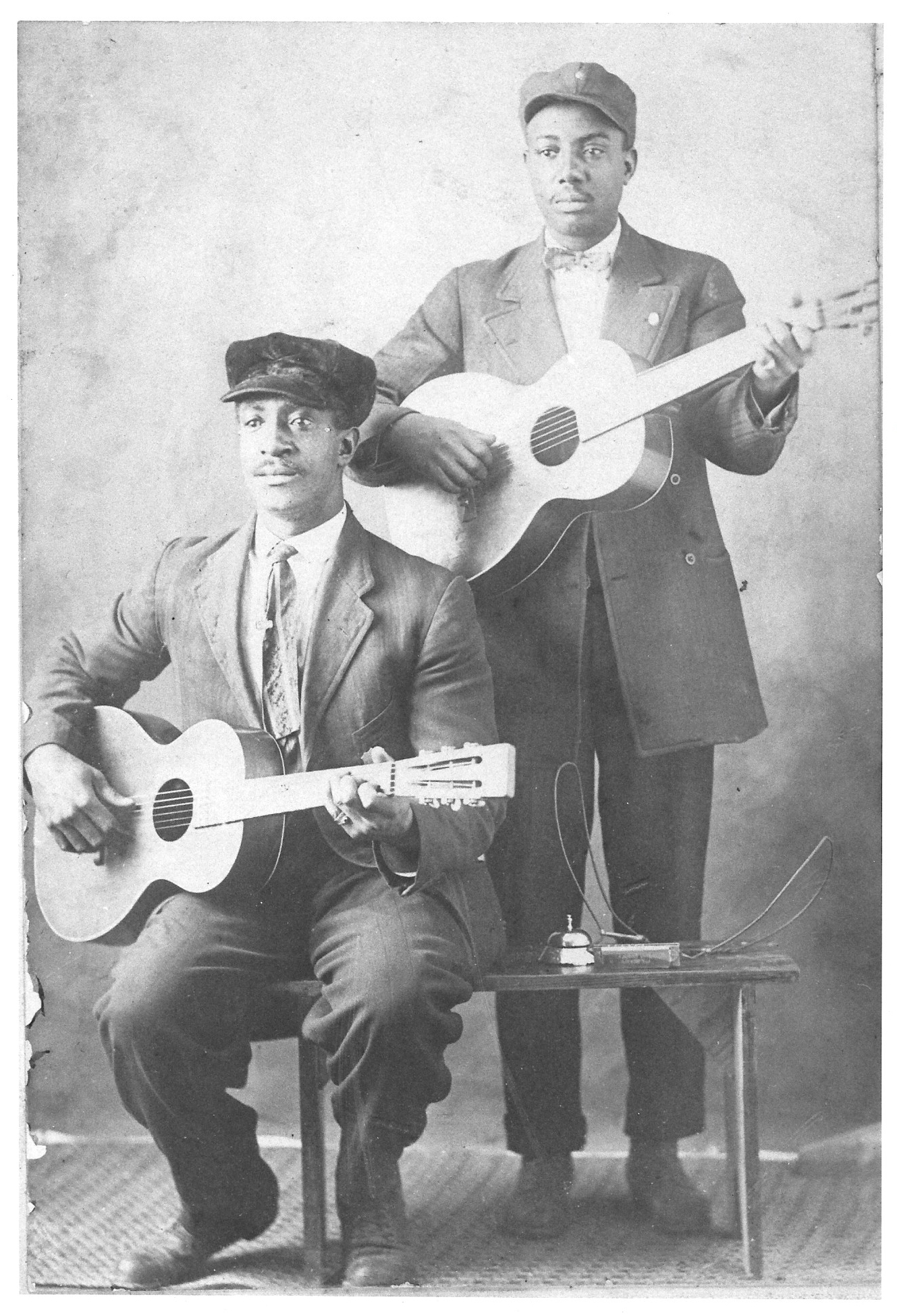 Floyd Meade (seated) and unidentified man (possibly nephew Emmett Meade, Jr.)