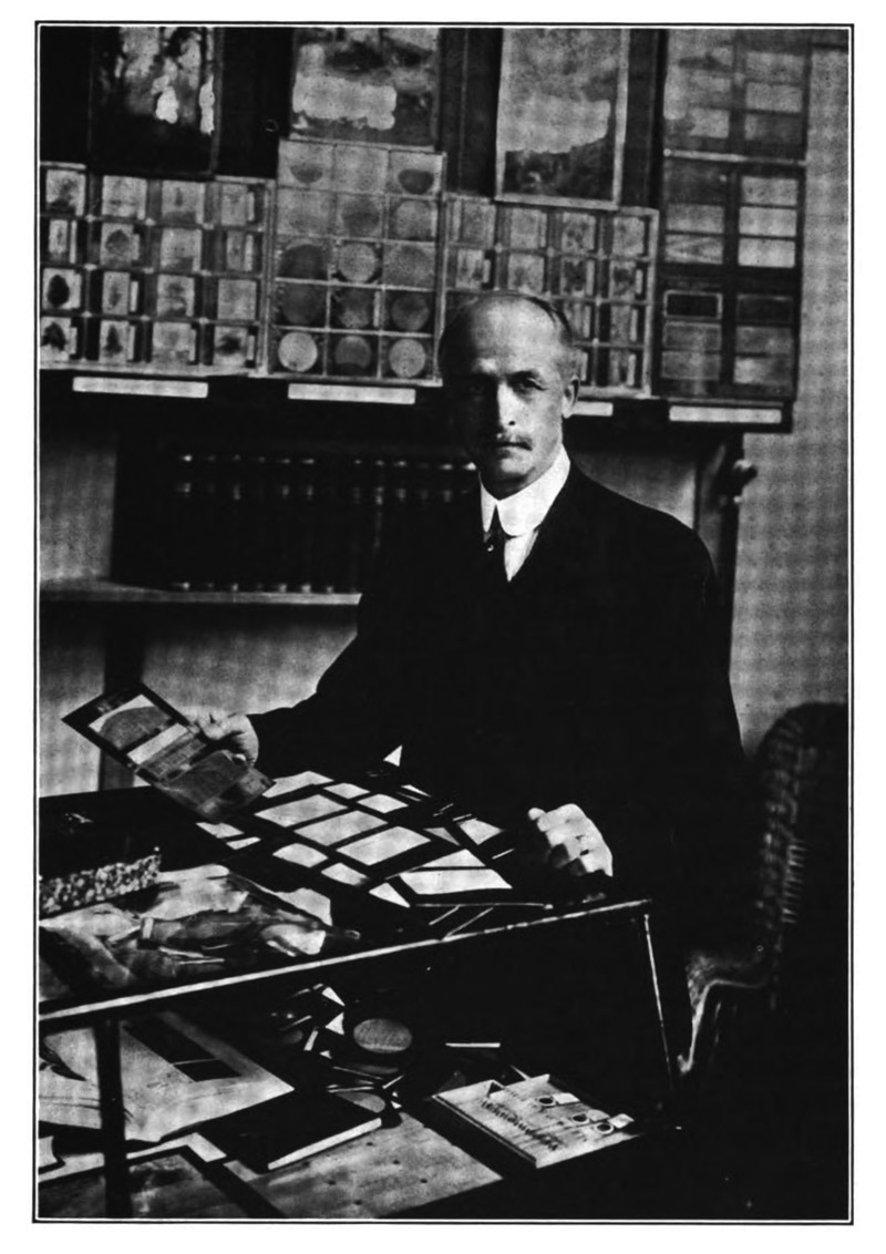 """Romeyn Beck Hough with his samples, from <em>California's Magazine</em> (1916), Hough's """"American Woods,"""" vol. 2, p. 285."""