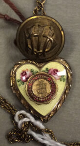 Button with VPI initials and locket with VPI seal