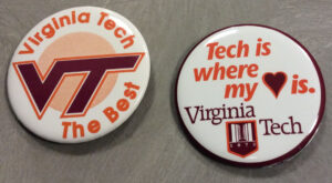 Buttons with the university logo and athletic logo