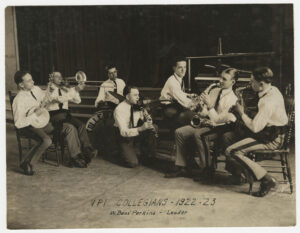 Collegians photo #2, 1922-1923, Historical Photographs Collection, from left: L.A. Lukie Hall (tenor banjo); J.B. Cole (trumbone); R.S. Bob Skinner (traps); W. Bass Perkins (clarinet, violin, leader); Tom S. Rice (piano); W.D. Willie Harmon (saxophone); F.R. Piggy Hogg (saxophone, traps, manager); and S.C. Stanley Wilson (trumpet, not pictured).